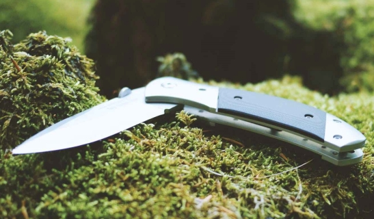 gray and black folding pocket knife